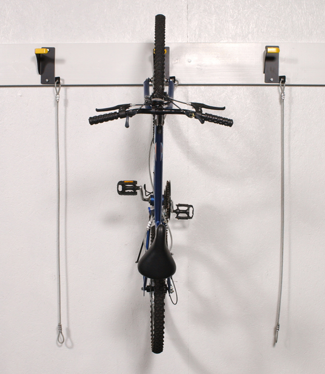 Wall Riders can be hung side by side, but are normally staggered to help offset handle bars to reach the needed quantity and maximize bike storage on unused wall space.