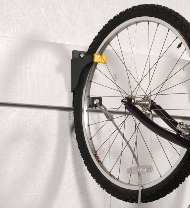 "The Bicycle Wall Rider is made of heavy-duty 11-gauge (1/8"" thick) steel, unlike other cheaper bike hangers, and secures the bike to the wall with an aircraft-quality steel cable."