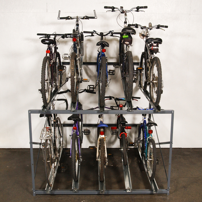 Bike Stacker multiple bicycle storage rack with various types of bikes.